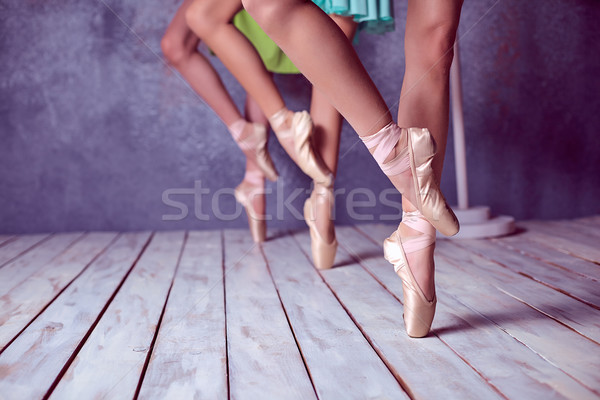 Stock photo: The feet of a young ballerinas in pointe shoes