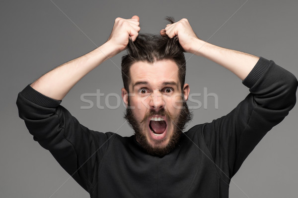 frustration, man tearing hair out in anger Stock photo © master1305