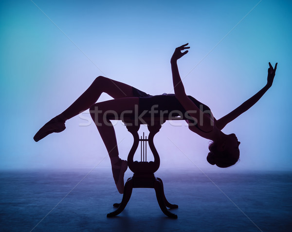 The silhouette of young ballerina on the wooden table  Stock photo © master1305