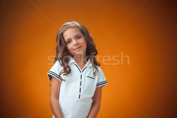 Cute vrolijk meisje oranje portret meisje Stockfoto © master1305