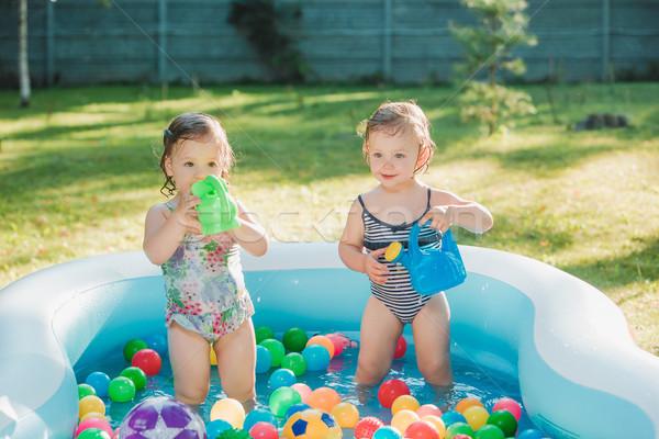Kettő kicsi lánycsecsemők játszik játékok felfújható Stock fotó © master1305