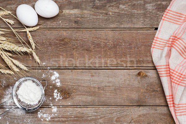 The flour  and eggs on an wooden background Stock photo © master1305