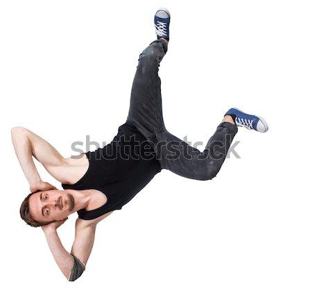 Break dancer doing one handed handstand against a white background Stock photo © master1305