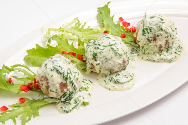 Húsgombócok mártás friss gyógynövények fehér saláta Stock fotó © master1305