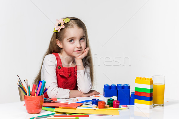 Cute little girl drawing with paint and paintbrush at home Stock photo © master1305
