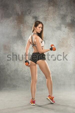 Sportos nő aerobik testmozgás piros súlyzók Stock fotó © master1305