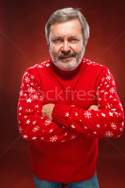 Elderly  smiling man on a red background Stock photo © master1305