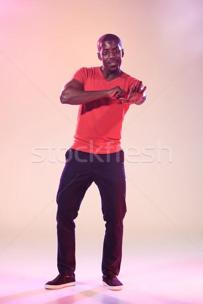 Genç serin siyah adam dans kırmızı gömlek Stok fotoğraf © master1305