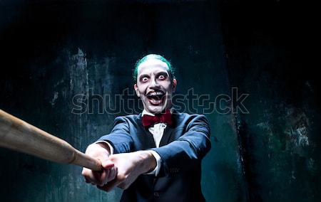 The scary clown and drip with blood on dack background. Halloween concept Stock photo © master1305