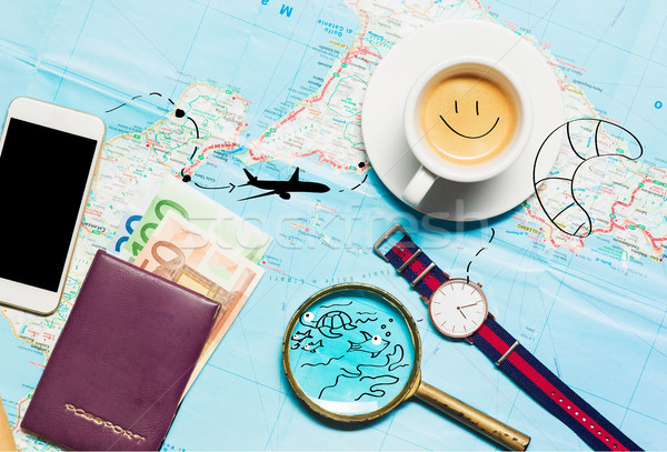 Preparation for travel concept - map, magnifying glass, cup of coffee, notepad, phone Stock photo © master1305
