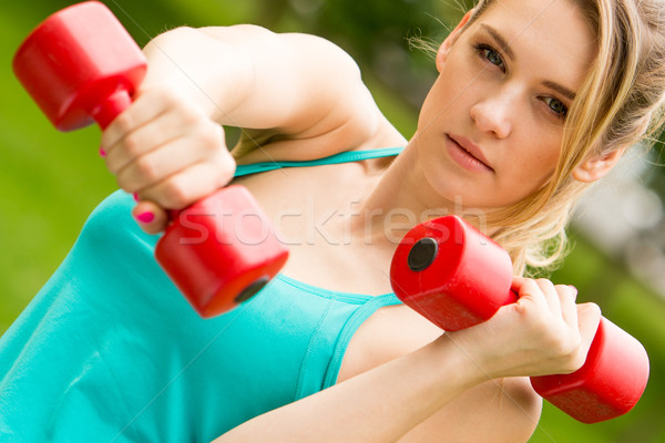 Sports girl exercise with dumbbells in the park Stock photo © master1305