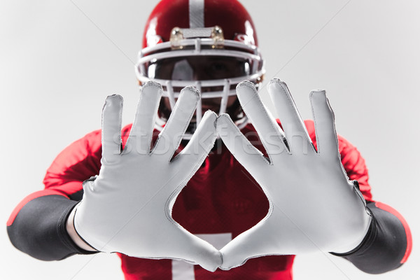 The hands of american football player on white  Stock photo © master1305