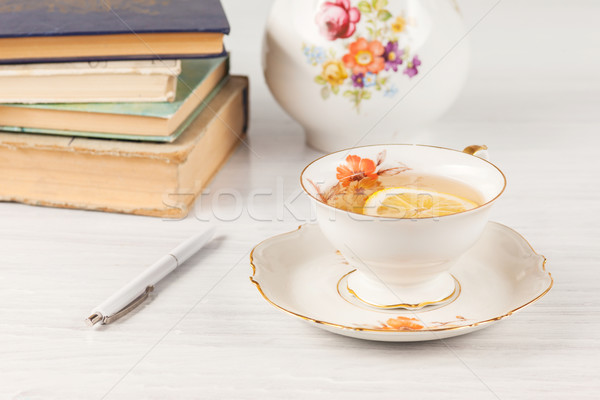 Stock photo: Tea with  lemon and books on the table
