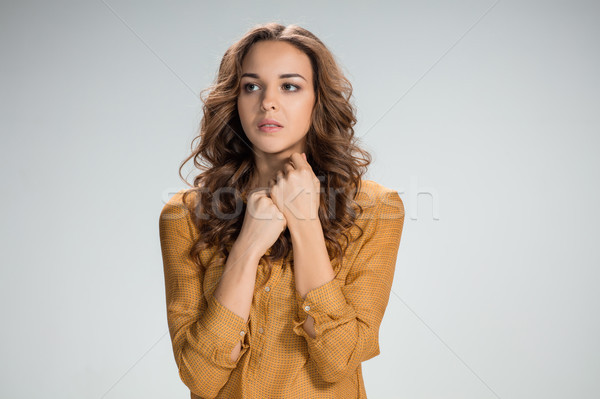 Woman is looking imploring over gray background Stock photo © master1305
