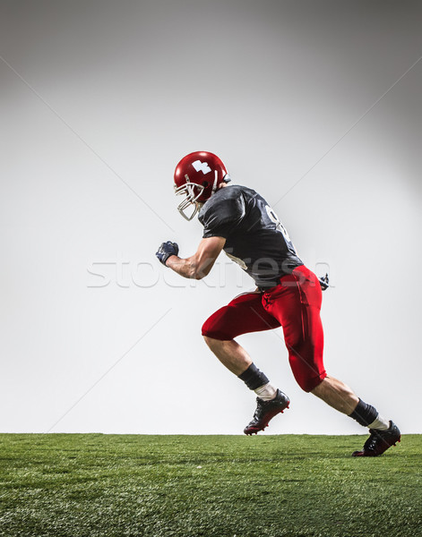 Stock photo: The american football player in action