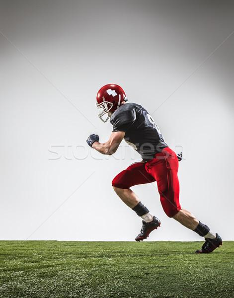 американский футболист действий зеленая трава серый Футбол Сток-фото © master1305