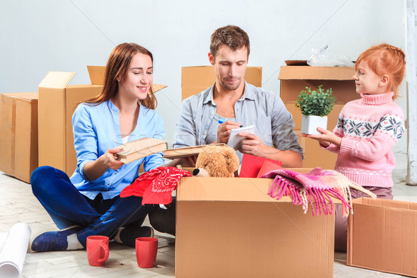 Stock photo: The happy family  at repair and relocation