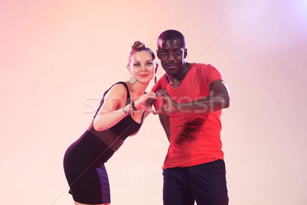 Genç serin siyah adam beyaz kadın kırmızı Stok fotoğraf © master1305