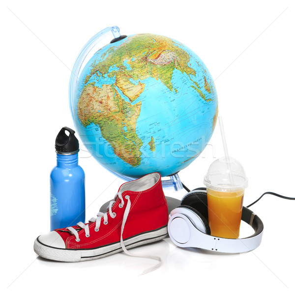 The blue globe, sneakers, thermos and headphones on white background. Stock photo © master1305