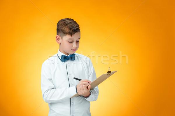 мальчика пер таблетка отмечает оранжевый стороны Сток-фото © master1305