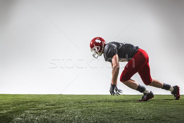 Americano futbolista acción hierba verde gris fútbol Foto stock © master1305