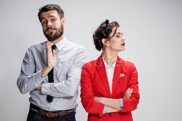 The sad business man and woman conflicting on a gray background Stock photo © master1305
