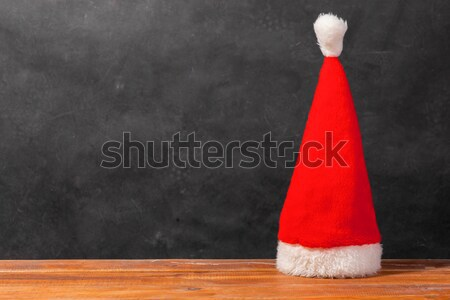 The Santa red hat on wooden background Stock photo © master1305