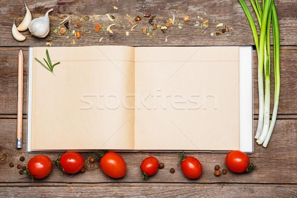 Open ricetta libro rosolare legno pomodori Foto d'archivio © master1305