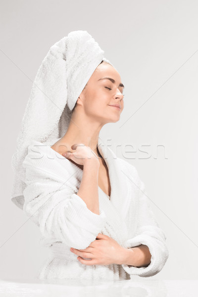Stock photo: The girl with a clean skin in bathroom