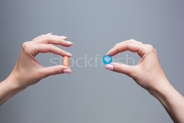 The female hands with sweet candy and pills  Stock photo © master1305