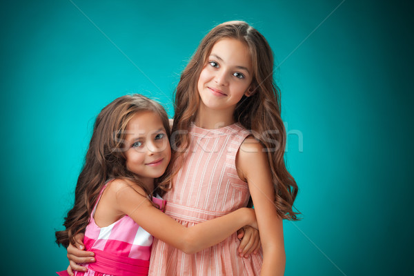 Twee vrolijk oranje cute meisje Stockfoto © master1305