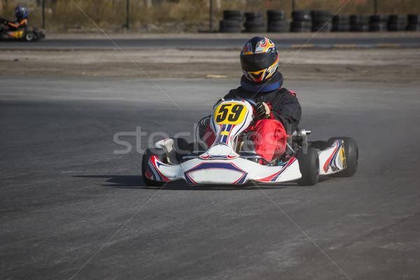 Karting - driver in helmet on kart circuit Stock photo © master1305