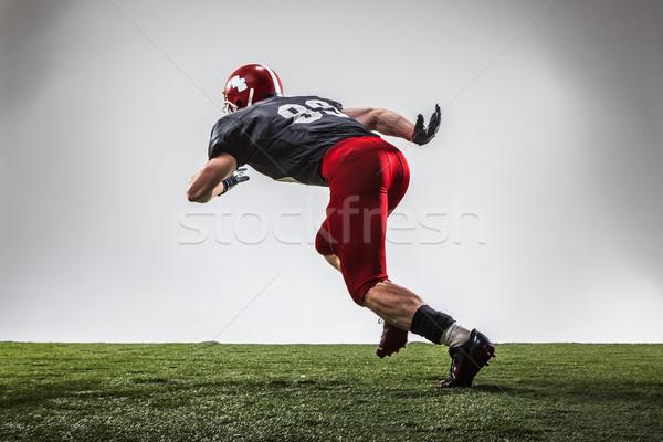 Сток-фото: американский · футболист · действий · зеленая · трава · серый · Футбол