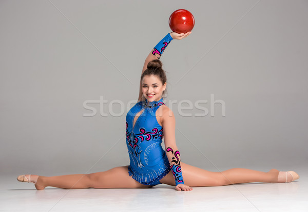 teenager doing gymnastics exercises with red gymnastic ball Stock photo © master1305