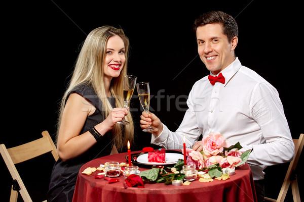 Portrait Of Romantic Couple Toasting white Wine At Dinner Stock photo © master1305
