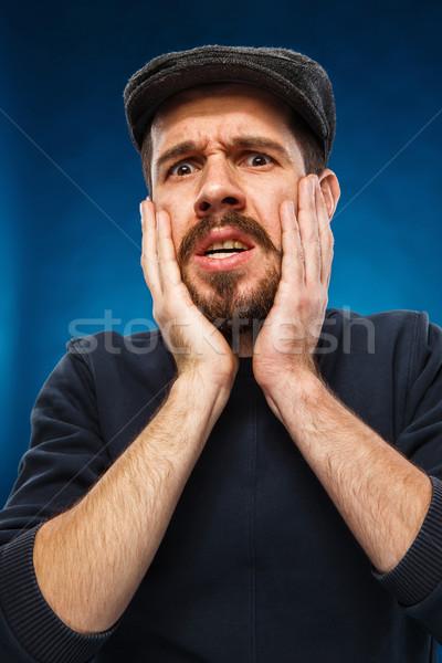 Raiva gritando homem retrato moço boné Foto stock © master1305