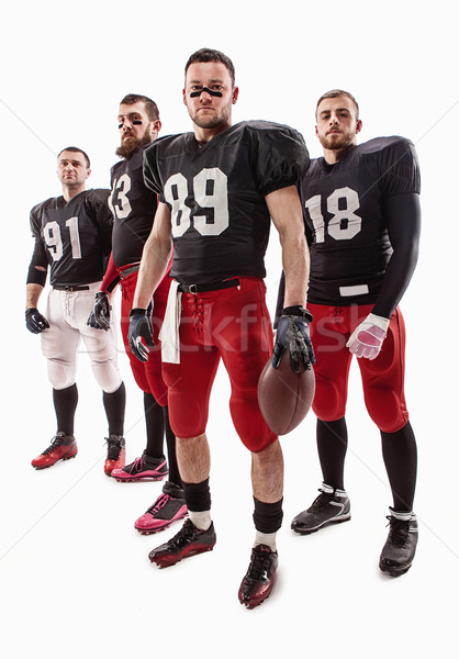 Quatre football joueurs posant balle Photo stock © master1305
