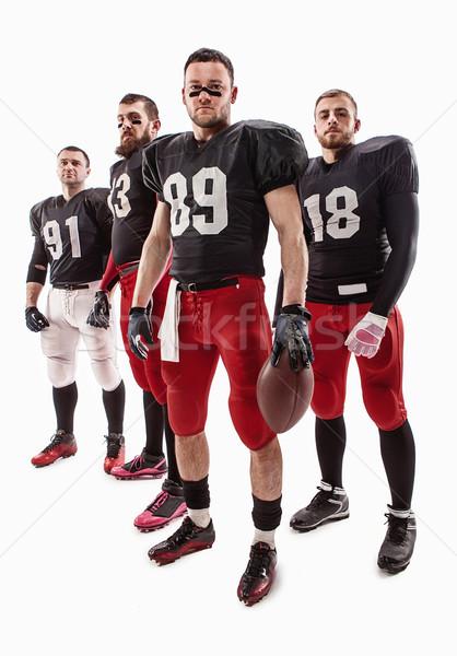 Quattro americano calcio giocatori posa palla Foto d'archivio © master1305