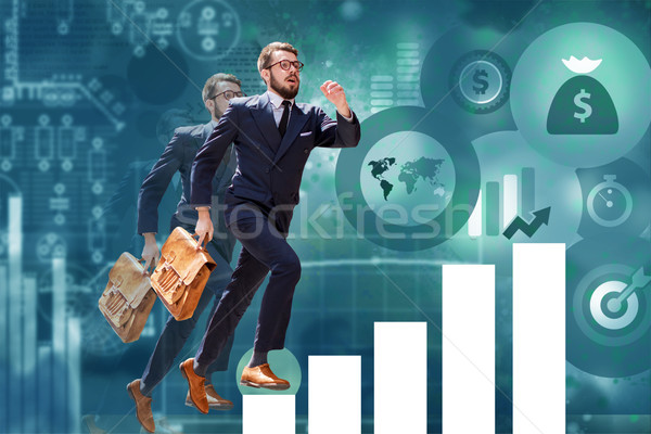 young businessman jumping over steps of chart or graph Stock photo © master1305