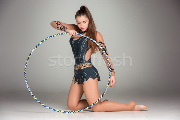 teenager doing gymnastics exercises with colorful hoop Stock photo © master1305