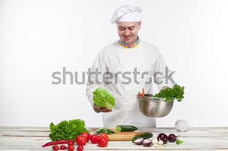 Chef cooking fresh vegetable salad in his kitchen Stock photo © master1305
