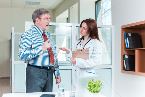 Doctor and patient at the medical office Stock photo © master1305