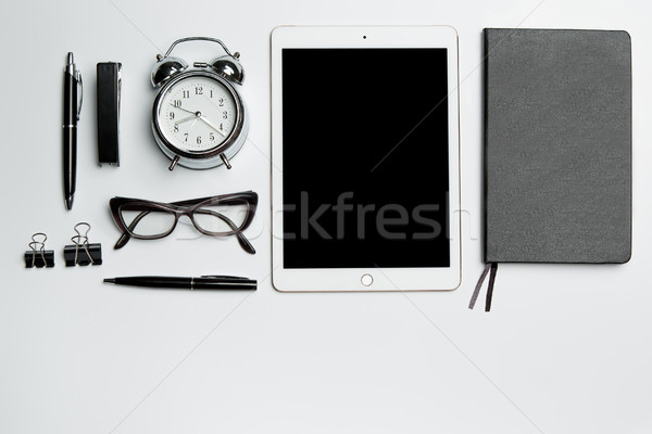 Office desk table with laptop, supplies, phone and coffee cup. Stock photo © master1305