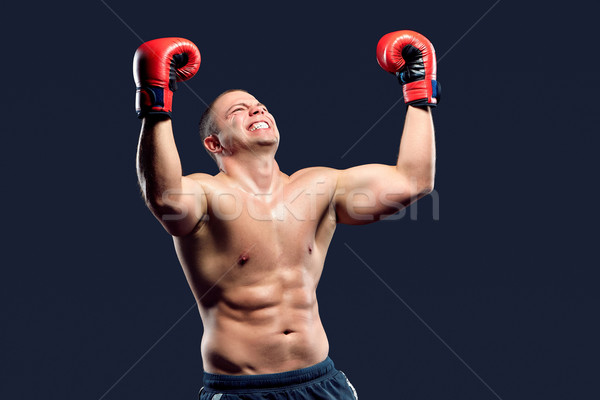 Portrait of a boxer champion enjoying his victory. Studio shot. Stock photo © master1305