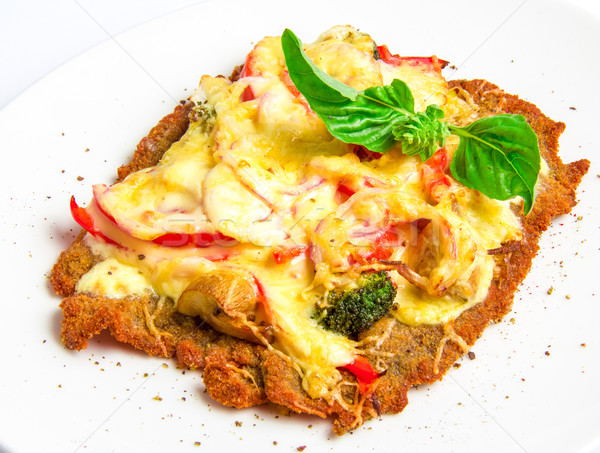 Crispy veal schnitzel with cheese, tomatoes, peppers, broccoli and mushrooms Stock photo © master1305