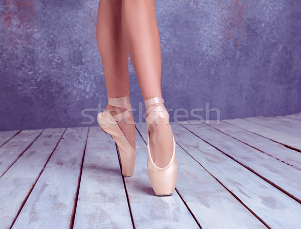 The feet of a young ballerina in pointe shoes  Stock photo © master1305