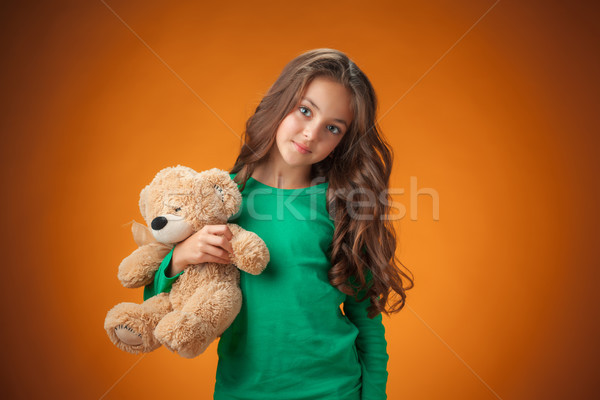 Cute vrolijk meisje oranje teddybeer meisje Stockfoto © master1305
