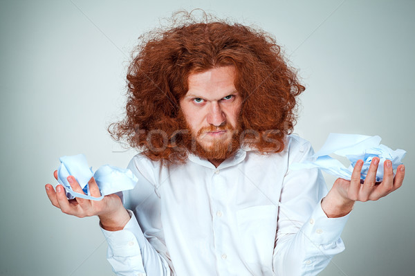 Zangado homem rasgar fora papel cinza Foto stock © master1305