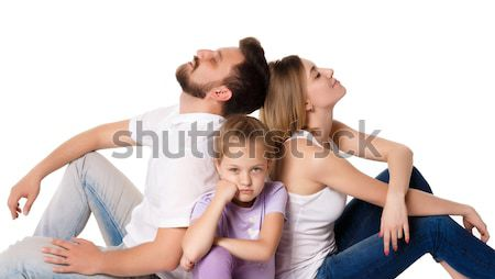 The tired family sitting on white background Stock photo © master1305