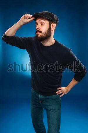 Férfi fiatalember sapka kék üzlet iroda Stock fotó © master1305